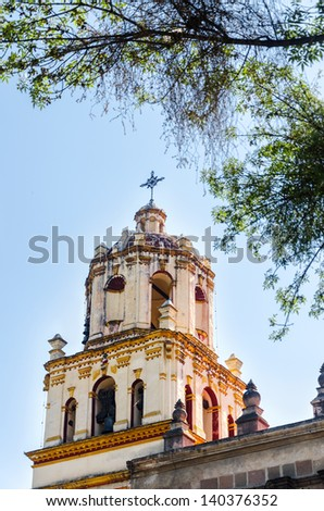 Spire of a church in Coyoacan neighborhood of Mexico City - stock photo