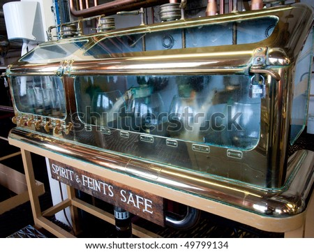 Spirit and feints safe in Islay distillery - stock photo