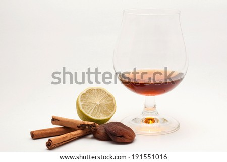 spirit in a glass with spices and flavors, isolated - stock photo