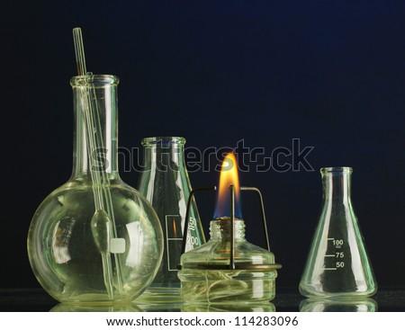 spiritlamp and test-tubes on blue background - stock photo