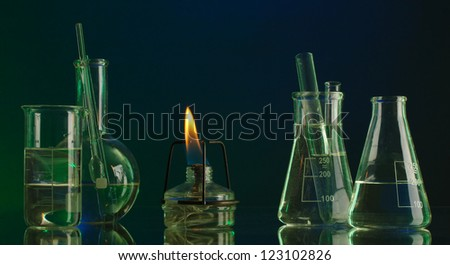 spiritlamp and test-tubes on  blue-green background