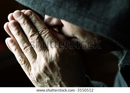 spiritual (special toned photo f/x, focus point on the hands(fingers) and face) - stock photo