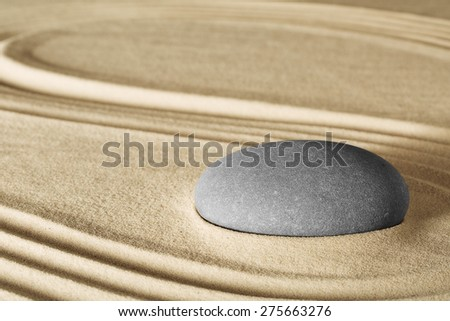 spiritual zen meditation in Japanese rock garden concept for harmony balance simplicity sand and pebble tao or Buddhism spa wellness massage stone therapy background - stock photo