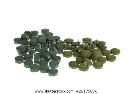 spirulin and chlorella food supplements tablets - stock photo