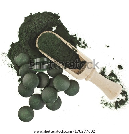 Spirulina algae green powder and tablets in spoon , isolated on white background  - stock photo
