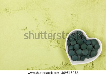 Spirulina; chlorella and wheatgrass. Green food supplement. Green pills and ground powder. Healthy lifestyle. - stock photo