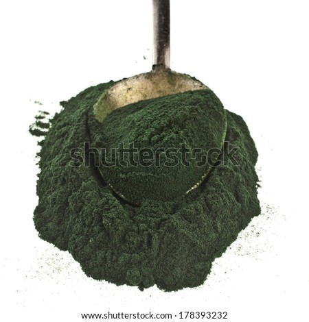 Spirulina powder - algae, nutritional supplement in spoon  isolated on white background  - stock photo