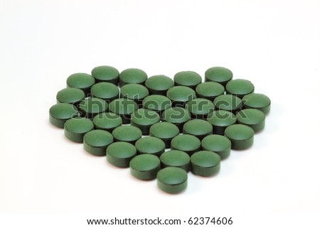 Spirulina tablets in heart shape.