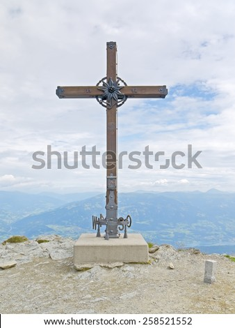 Spittal/Drau, AUSTRIA - 07  August 2014: The cross of the summit of the mountain Goldeck, which is an excursion destination and a winter sport region.  - stock photo