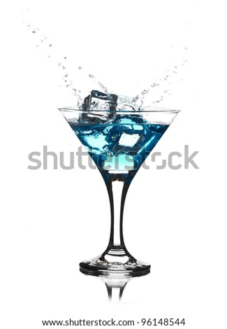 Splash from pouring martini into the glass. - stock photo