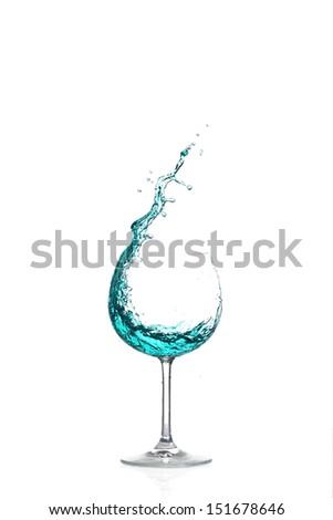 Splash green cocktail on white background - stock photo