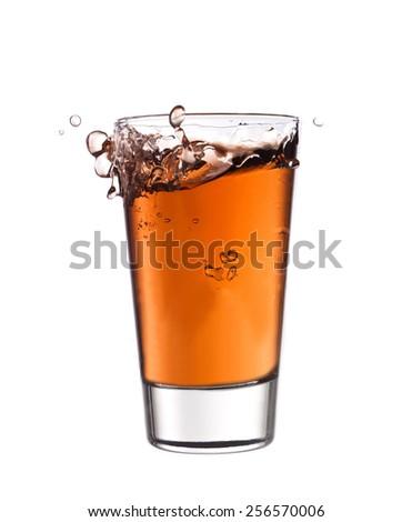 Splash in a glass of red lemonade - stock photo