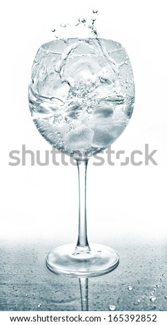 Splash in glass in drops of water