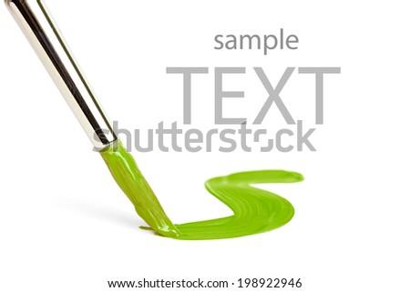 splash of green paint and brush  - stock photo