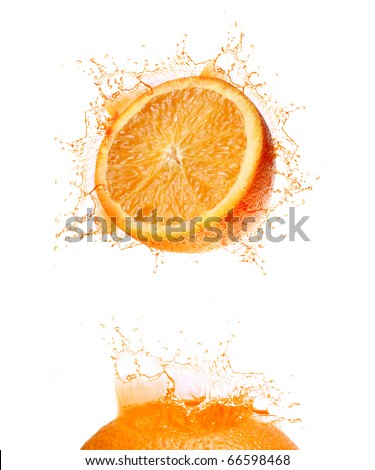 Splash of orange drink - stock photo