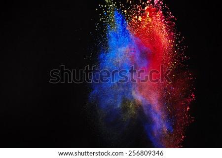Splash of paint on black background - stock photo