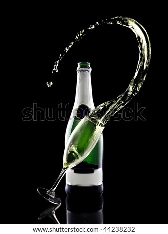 Splash of shampagne with bottle and glass - stock photo