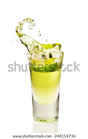 splash of tequila from the falling pieces of lime isolated on white - stock photo