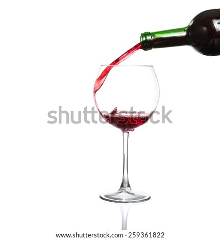 Splash red wine glass against a white background - stock photo