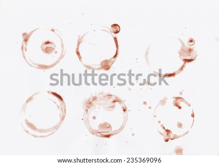 Splashes and traces of coffee cup. Circles and rings on white background.  - stock photo