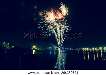 Splashes in colourful fireworks in the night sky. - stock photo