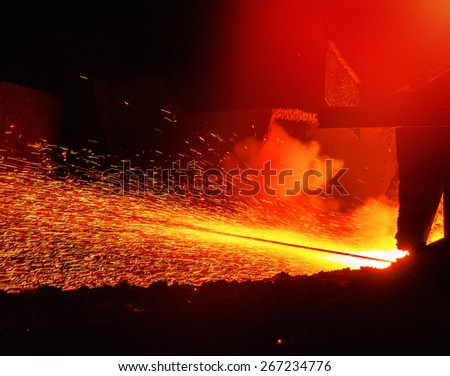 splashes of hot metal with the release of iron - stock photo