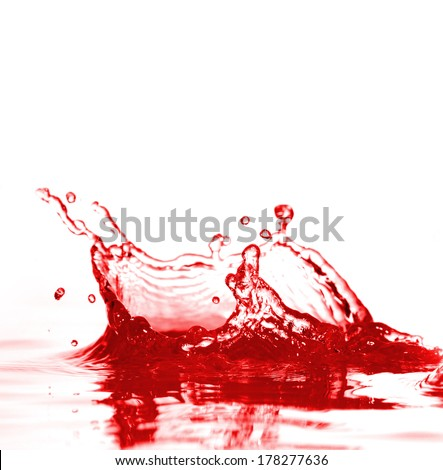 splashes of red wine on a white background