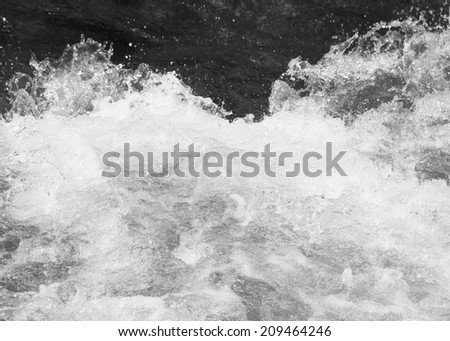 splashes of water in the river - stock photo