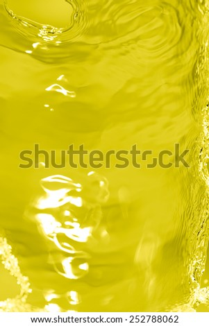 splashes of water on a yellow background - stock photo