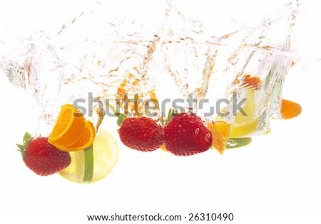 splashing fresh fruits into water - stock photo