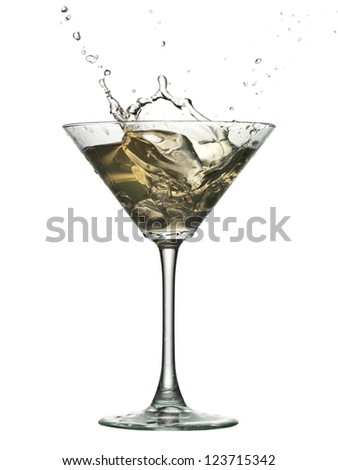 Splashing glass of cocktail with ice