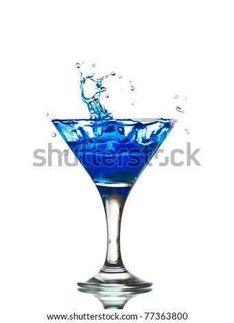 splashing into a martini isolated on white - stock photo