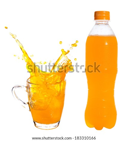 Splashing of orange juice with ice in glass on white background. - stock photo