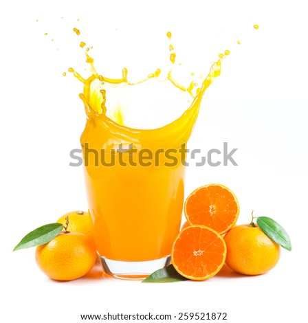 splashing orange juice with oranges against white background - stock photo