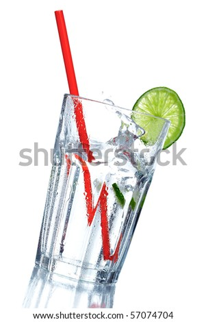 Splashing soda in a glass with drinking straw and lime decoration - stock photo