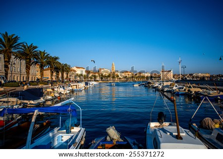Split city centre view from the quay with boats and yachts in the sunny evening in Croatia - stock photo