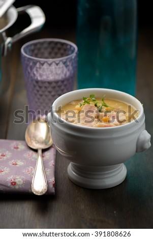 Split pea soup in a white bowl - stock photo