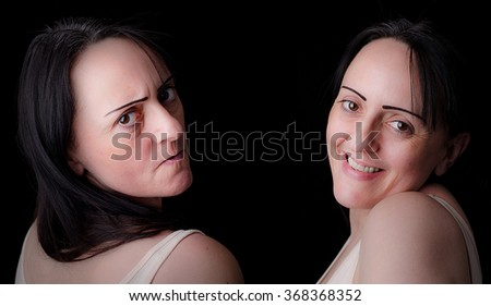 Split personality. Woman showing angry, irritated side and a caring, kind side. Black background with copy space. - stock photo