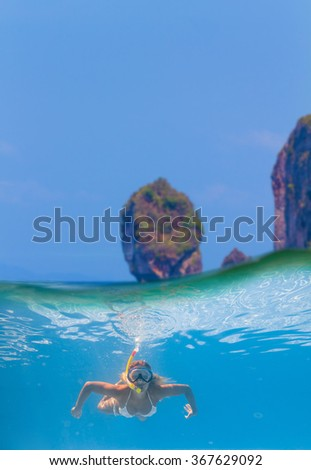 Split photo of a Young women at snorkeling in the tropical water - stock photo