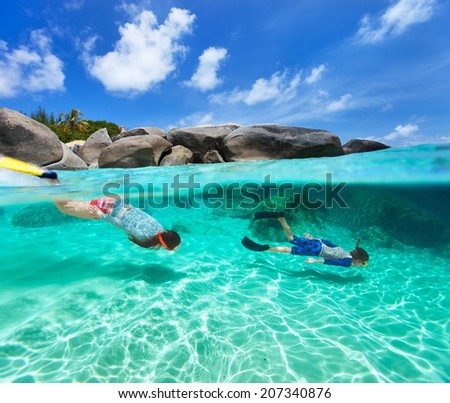 Split photo of mother and son family snorkeling in turquoise ocean water at tropical island of Virgin Gorda, British Virgin Islands, Caribbean - stock photo