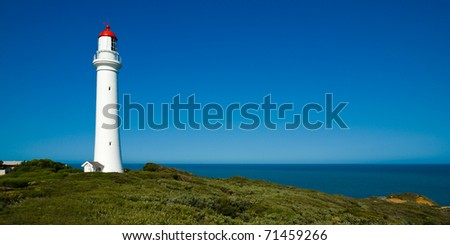 Split Point Lighthouse at Airey's Inlet on the famous Great Ocean Rd in Victoria, Australia - stock photo