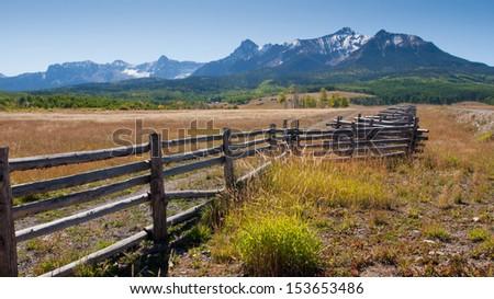 Split rail fence on the Last Dollar Ranch, Colorado. - stock photo
