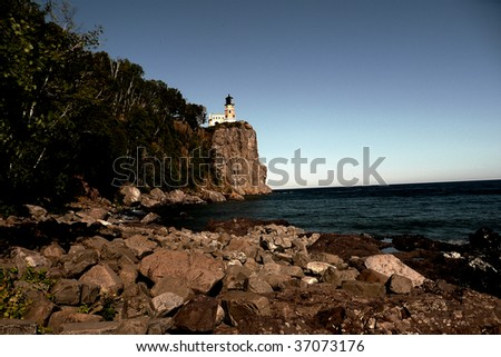 Split Rock lighthouse over Lake Superior in Minnesota - stock photo