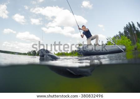 Fisherman rod boat underwater view stock photo 313825454 for Split shot fishing
