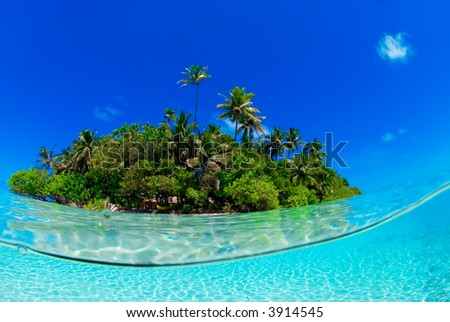 Split shot underwater of tropical island - stock photo