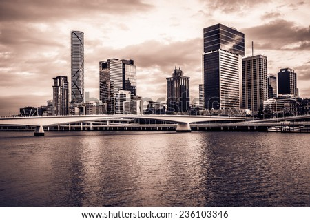 Split-tone image of the Brisbane River with the modern city of Brisbane on the background. - stock photo