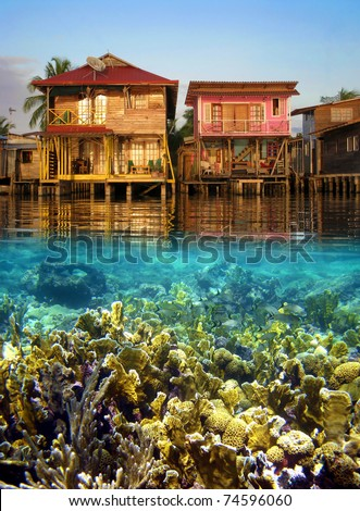 Split view with tropical houses over water and coral reef fish underwater, Caribbean sea, Panama