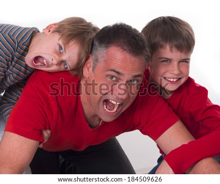 spoiled children on their father's back, challeges od parenting - stock photo