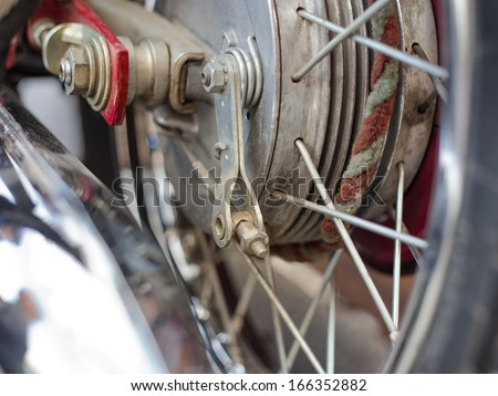 Spokes on a wheel of an old motorcycle. - stock photo