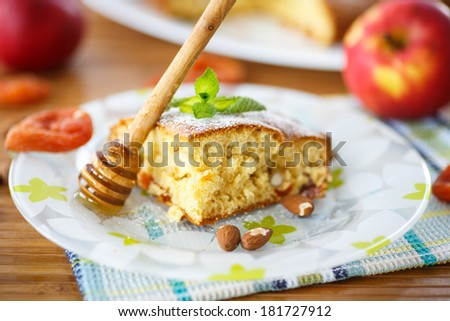 sponge cake with dried apricots, almonds and fruit